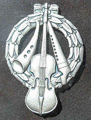 Zornmärket i silver.